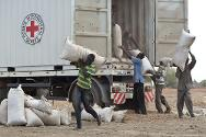 South Sudan. Workers unload a truck during an ICRC distribution.
