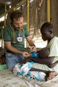 Malakal Hospital, Upper Nile state, South Sudan. An ICRC doctor attends to a child.