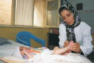 ICRC physical rehabilitation centre, Kabul. Karima, a physiotherapist, treats a child born with a club foot.