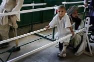 ICRC orthopaedic centre, Kabul. A boy practises walking with his new orthoses.