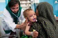 Mirwais Regional Hospital, Kandahar, Afghanistan. A member of the medical staff examines a child.