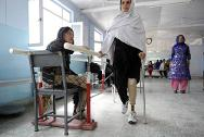 ICRC physical rehabilitation centre, Kabul, Afghanistan. Disabled Afghan women practice walking on their artificial legs.
