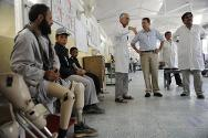 ICRC physical rehabilitation centre, Kabul, Afghanistan. ICRC president Peter Maurer listens to the head of the ICRC rehabilitation project, Alberto Cairo.