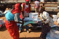 Central African Republic, Bria. The ICRC and the Central African Red Cross Society distribute essential relief supplies to approximately a thousand families whose houses were destroyed or seriously damaged in clashes between two armed groups.