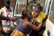 Côte d'Ivoire, Zouan-Hounien department, Ligaleu. A girl is reunited with her family.