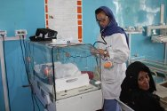 Afghanistan, Kandahar, Mirwais Regional Hospital. A nurse monitors the condition of a baby in an incubator; the infant is one of several newborns in the paediatric ward.