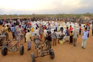 Somalia, Gedo region. After the food distribution, the supplies are carried away on donkey carts.