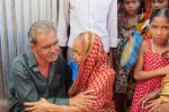 Bishnurampur village, Mymensingh, Bangladesh. Moslem Uddin Sarker is reunited with his mother after 23 years imprisonment.