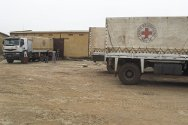 Gorum-Gorum, Oudalan Province, Burkina Faso. Staff unload trucks that have just arrived from Côte d'Ivoire bearing essential household items for Malian refugees who fled the fighting.