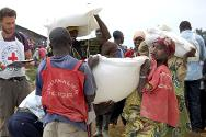 Democratic Republic of the Congo. Displaced people collect food. Each family received 60 kg of flour, 20 kg of peas, 6 litres of oil, plus salt.