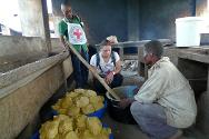 Osio Detention Camp, Orientale Province, DRC. ICRC staff check the quality of the food served to inmates.