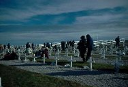 Malvinas, Falkland Islands. Relatives of Argentinian soldiers killed during the conflict lay flowers on the graves of their loved ones.