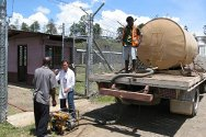 Papua New Guinea. An ICRC water engineer supervises the delivery of water to Bihure prison. The ICRC also provides assistance to prisons to help ensure adequate living and sanitary conditions, and reports to prison authorities to support them in meeting international standards and local rules.