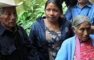 Juana with her grandparents, who raised her after her parents and siblings were forced to flee.