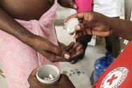 Civilian prison, Port-au-Prince, Haiti. A prisoner receives medication as part of a campaign against scabies and intestinal worms.