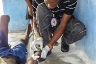 Les Cayes Prison, Haiti. An ICRC nurse inserts a drip into a prisoner's arm.