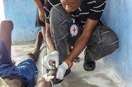 Les Cayes Prison, Haiti. An ICRC nurse inserts a drip into a prisoner's arm.