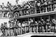 Some of the wounded aboard a boat on the River Paraguay on their way to city hospitals.
