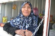 Eman proudly runs her shop, to make a living for her family.