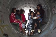 Nitzan, southern Israel. People shelter in a sewage pipe following warning of a rocket attack.