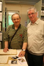 George Jaunzemis and his cousin Joachim Sumpmann look at documents from the 150-page tracing file that the ITS created in response to his mother's attempts to find her son.