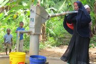 Pemba, Tanzania. A woman pumps water from a well constructed by the ICRC.