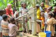 Pemba, Tanzania. ICRC water engineer Eugenio Vagni joins children in pumping water at a well constructed by the ICRC.