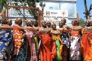Kenya. Women crowd around a newly installed ICRC water storage tank.