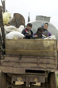 Northern Lebanon. A Syrian woman sits in a truck with her children after fleeing the unrest in Syria.