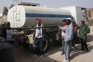 Libya. The ICRC fills water tanks with fresh water.