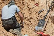 Libya. An explosive ordnance disposal operator removes unexploded ordnance from the ground.