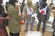 Aguelhoc, Kidal, northern Mali. Staff distribute food to displaced persons.