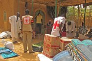 Mopti Branch, Malian Red Cross, central Mali. Red Cross volunteers distribute food and basic household items to families displaced from northern Mali.