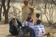 Oudalan province, Burkina Faso. A Burkina Faso Red Cross volunteer registers a family of Malian refugees in April 2012.