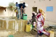 Kidal, north-eastern Mali. People collecting water at a well.