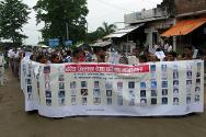 Gulariya, Bardia district. The families of missing persons marched in a rally led by an association of conflict victims (Conflict Victim Committee – CVC), carrying placards and a large banner containing photographs of missing persons in Bardia district.