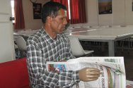 Retired Major Gunja Karki can read a newspaper and write unaided after receiving a new artificial limb from the ICRC.