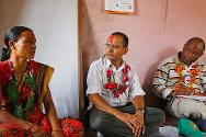 Banke District, Nepal. Yubaraj Adhikari (head of the ICRC psychosocial support project) interprets between Sita and his ICRC colleagues.