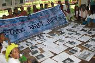 Nepal. Wives and mothers of missing persons with their families during a commemoration ceremony for their missing relatives.
