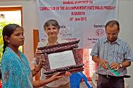 Gulariya, Bardia district, Nepal. ICRC head of delegation Sylvie Thoral hands over a certificate of appreciation to Tharu Women Upliftment Center president Lilawati Tharu.