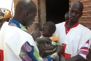 Kabéfo, Abala department, Tillabéry, Niger. Red Cross volunteers assess the nutritional health of a child.