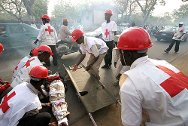 Kano, Nigeria. Nigerian Red Cross volunteers administer first aid during an exercise.