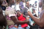 Namasibiri, Niger Delta, Nigeria, November 2011. A child receives a vaccination at an ICRC temporary clinic.