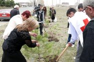 Gyumri, Armenia. Local TV station Tsayg films Armenian Red Cross personnel as they help people plant trees to remember relatives missing since the Nagorny Karabakh war.
