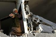 Gaza City. A man checks his damaged house, 15 November 2012