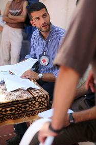 A delegate talks to detainees during an ICRC visit of Ramon prison in Israel.