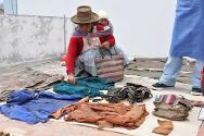 Peru, Ayacucho. Families try to identifiy the clothes of their missing relatives.