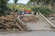 Caraga, Davao Oriental, Philippines. With this bridge destroyed by typhoon Bopha, vehicles can no longer use the most direct major road along the coast. The ICRC is finding other means and routes to bring relief to people in the worst-hit part of Davao Oriental.