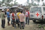 New Bataan, Compostela Valley province, Eastern Mindanao, Philippines. After this area was badly hit by mudslides and flash floods brought on by typhoon Bopha on 4 December, a joint ICRC/Philippine Red Cross team prepare to distribute aid to survivors.