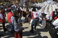 Davao Oriental, Baganga municipality. In the wake of typhoon Bopha, a joint ICRC/Philippine Red Cross team distribute emergency food kits and basic household items.